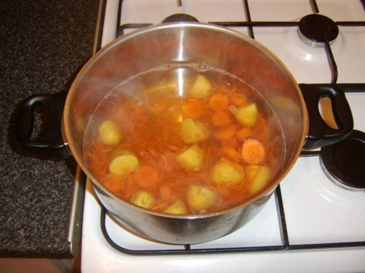 Potatoes, carrots and beef stock are added to pot and seasoned