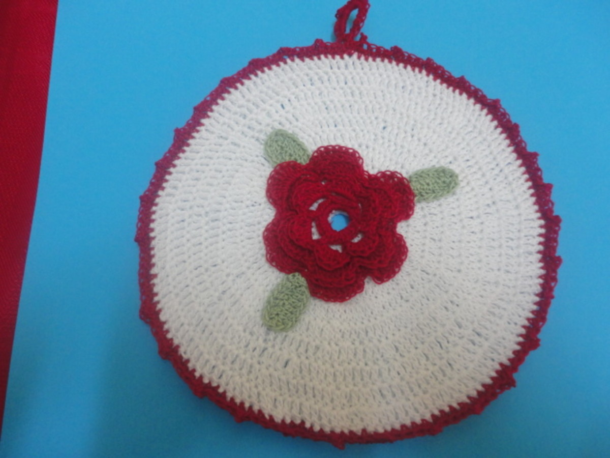 Crochet Rose Potholder done in size 10 crochet thread.