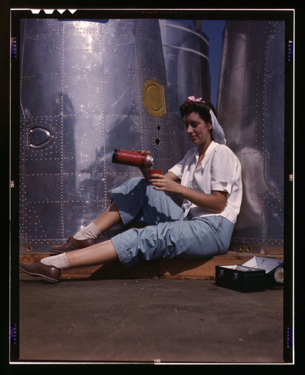 Jeans circa 1942 - Publicity shot of female worker taking a break from factory work.