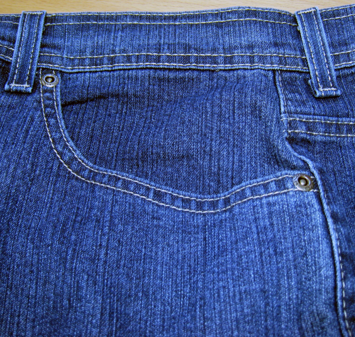 Jeans with riveted pocket