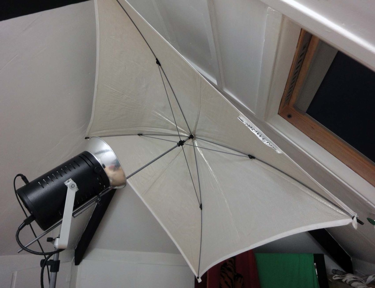 Studio light and umbrella in loft conversion photographic studio