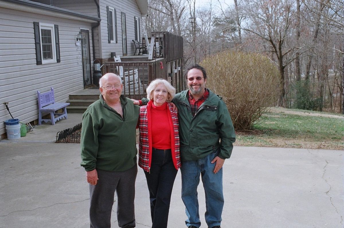 MIKE HERRERA WITH HIS MOM AND DAD OUTSIDE THEIR HOME