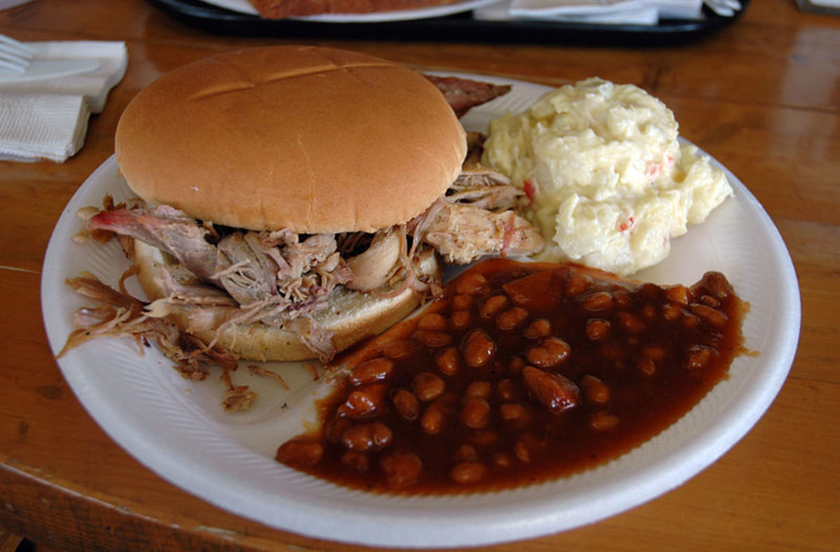 Pulled Pork Sandwich With Potato Salad And Baked Beans.