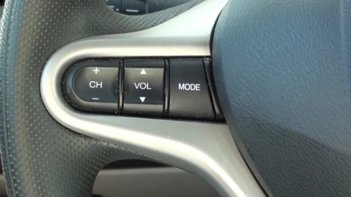 You can also control your iPod from the left side of the steering wheel.
