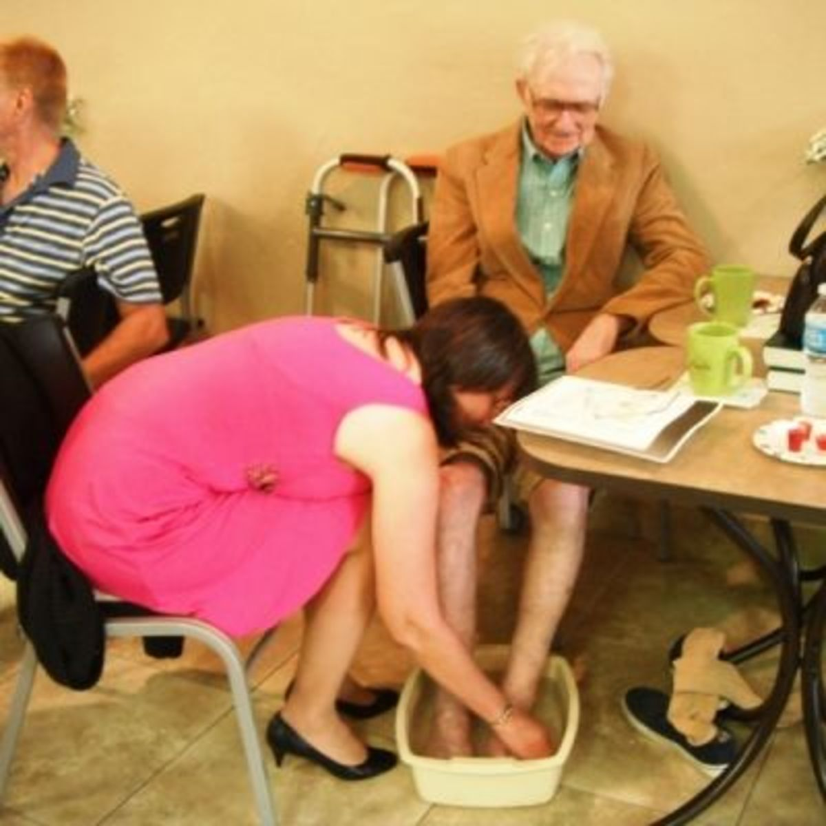 Toni washing her 90-yr-old Dad's feet at Love Feast 2013