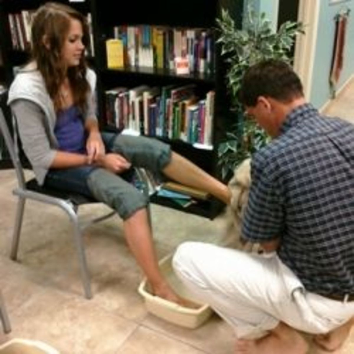 Father Washes Daughter's Feet at Love Feast