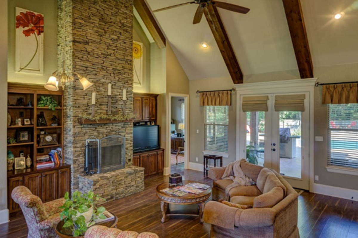 Beautiful interior that'll be a dream to live in. Notice the stone works, vaulted ceiling, and the classic wood floor. There is a blend of the traditional and contemporary.