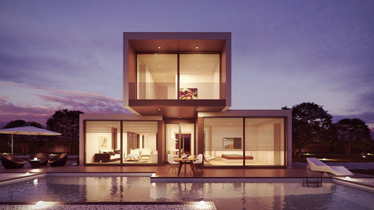 An ultra-modern dream home design with an open plan interior and elaborate glass wall.