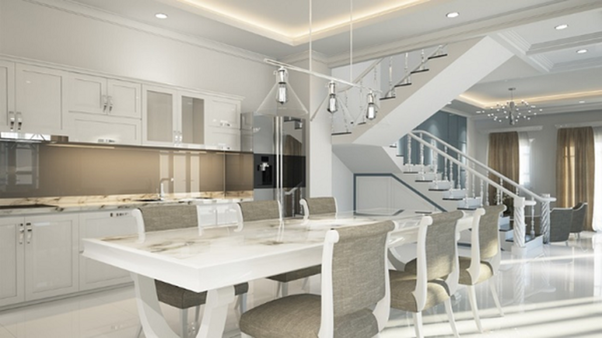 A beautiful contemporary minimalist theme interior of a residential home. Its design shows how a kitchen space and dining area flow into each other