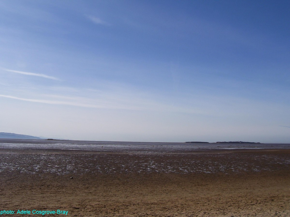West Kirby beach, with the three islands - Little Eye, Middle Eye and Hilbre - on the horizon.