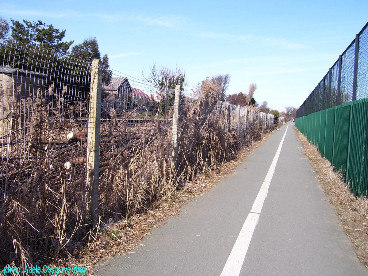 Public footpath - the high fence on the left extends only the length of the adjacent sports ground.