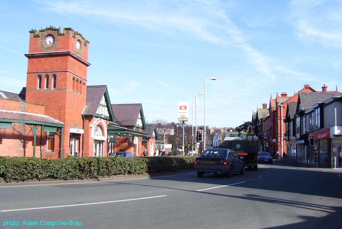 Grange Road and the entrance to West Kirby train station.