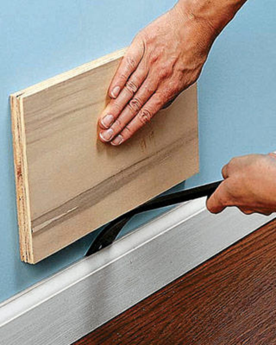 pry baseboard off, being careful not to damage your walls