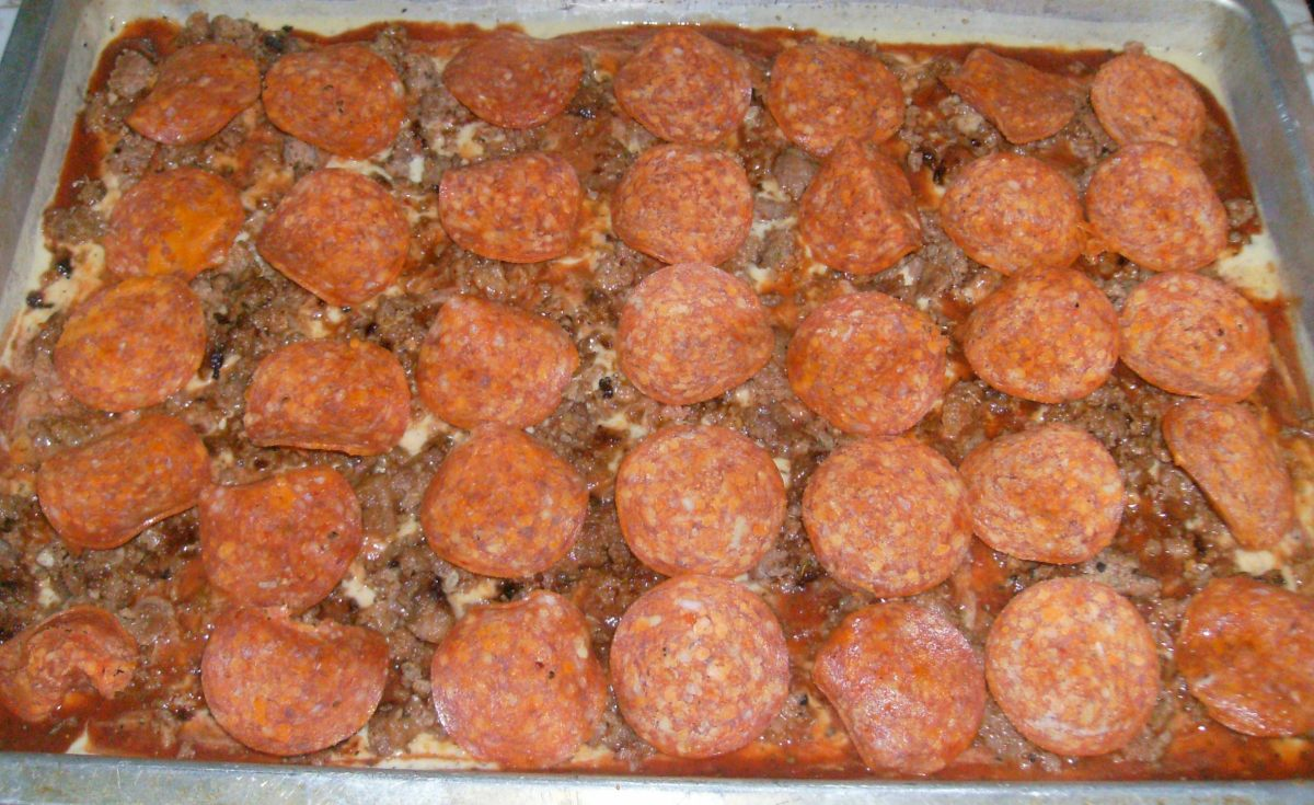 Start layering the Italian sausage and Pepperonis.