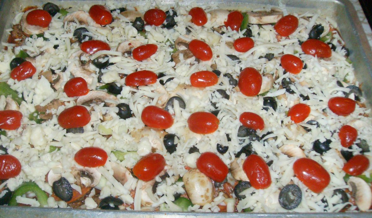 Add shredded cheese and halved cherry tomatoes. Loaded and ready to go in the oven!