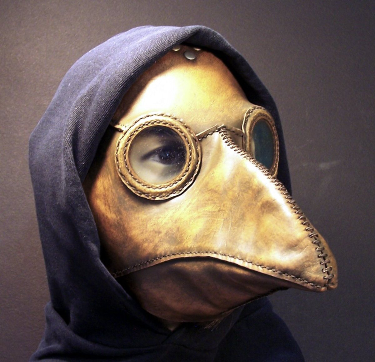 """Leather """"plague doctor"""" face mask. The """"beak was stuffed with aromatic herbs and essential oils to protect the doctor.but must have been terrifying for the patient."""