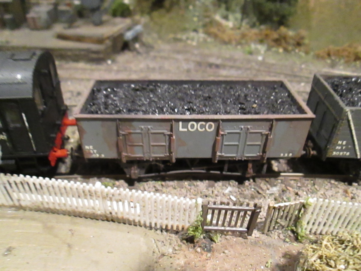 Steel-built LNER 'cupboard door'' loco coal wagon complete with painted 'rust', bent tension bar, muck and load