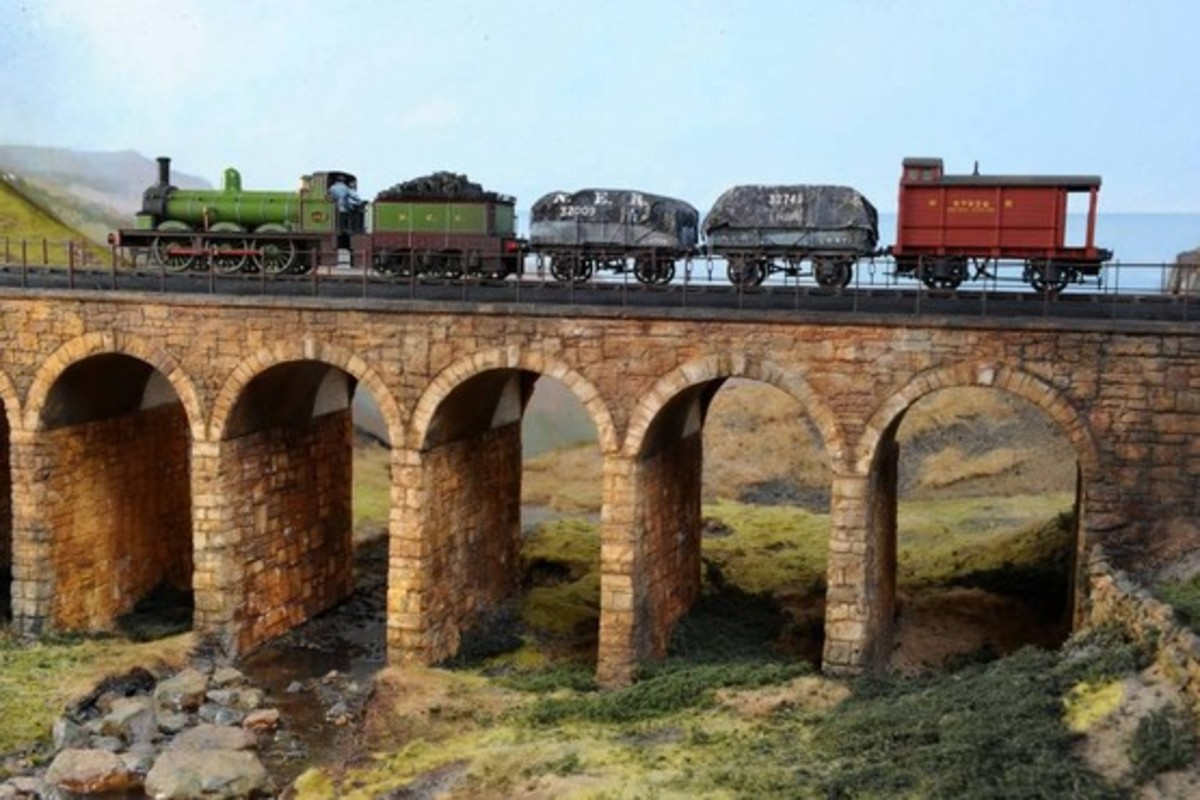 The viaduct - a module added to the layout - with a very short pick-up goods going over. Vintage NER locomotive and rolling stock.  Note the 'Birdcage' Brake