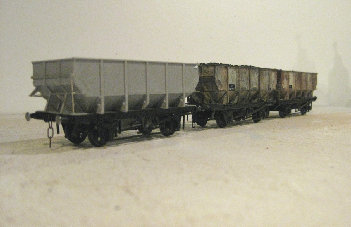 Trio of Parkside BR Dgm 1/149 Steel hoppers (Kit PC77) based on LNER Dgm 100, of which there were variants. Nearest vehicle is as assembled before numbering, behind are numbered and weathered wagons as would have been seen anywhere on the system