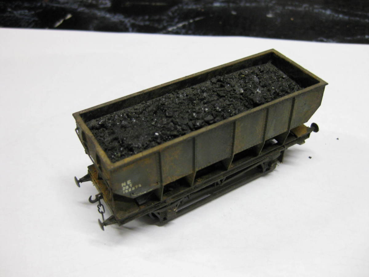 This is one of my own re-worked Dapol 21 ton LNER steel-built mineral hoppers with de-mountable load. Basically 2.5mm plastic card, layered, painted, PVA-spread, sprinkled with real coal granules. Raised to height with plastic blocks added to ends