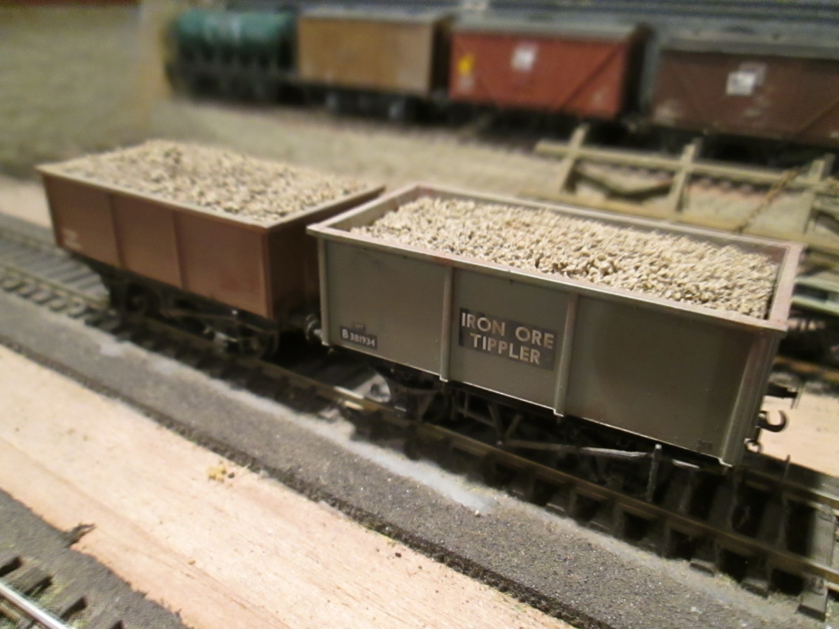 A pair of laden Hornby Iron Ore tipplers on Fiddleyard 1 of the Thoraldby layout.
