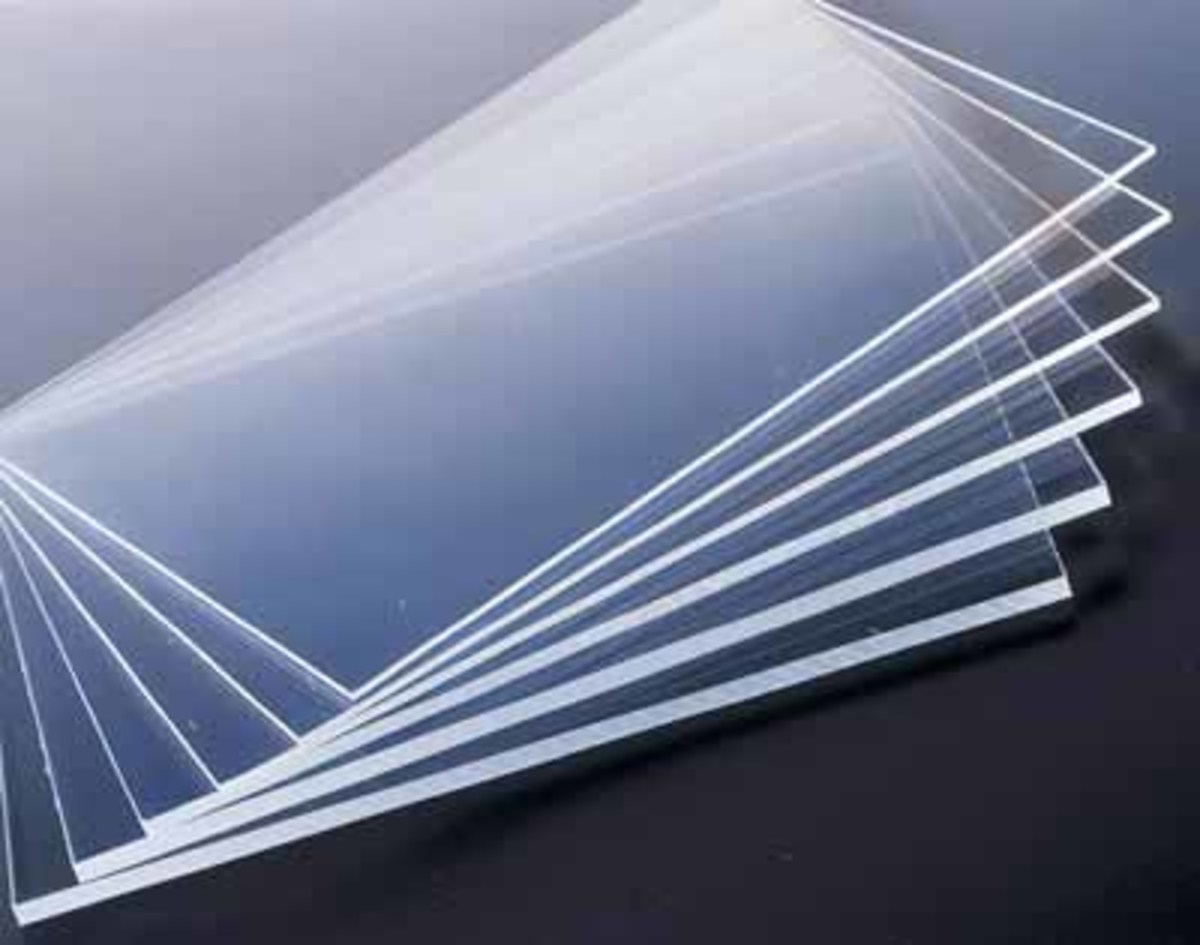 Making garage door windows from plexiglas sheets is a cost effective alternative to glass.