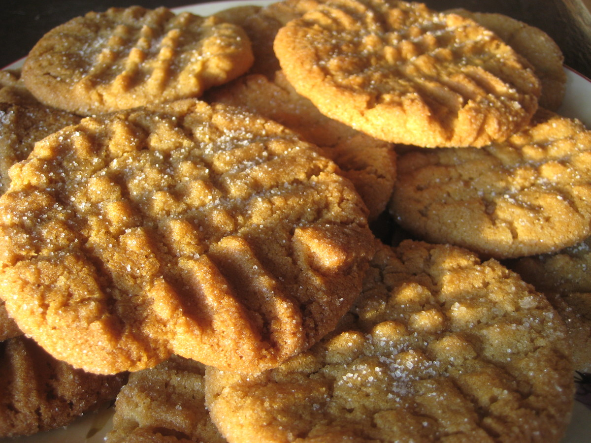 Soft and chewy yet crisp around the edges, these are the perfect peanut butter cookies. A dusting of sugar adds an extra bit of sweetness and texture, and helps keep them from sticking to the cookie sheet.