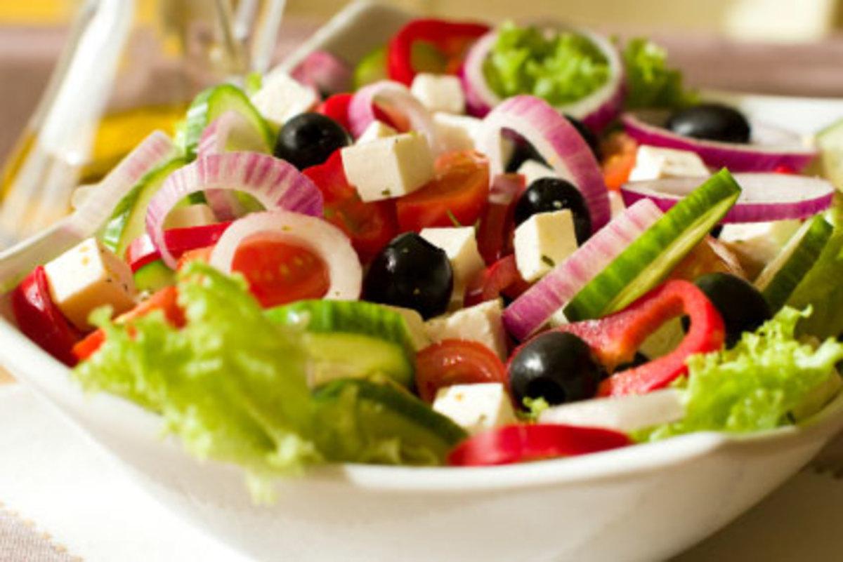 Fresh Greek salad as an accompanying dish.