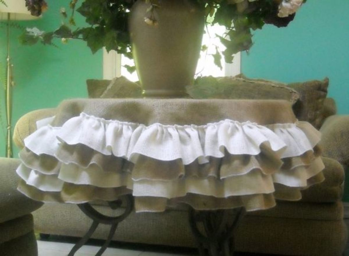 http://www.etsy.com/listing/49597455/ivory-burlap-tablecloth