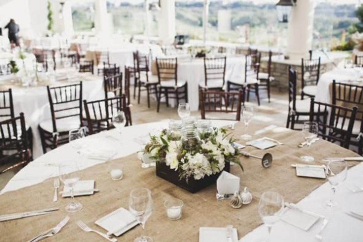 http://boards.weddingbee.com/topic/undecided-table-decor-need-help