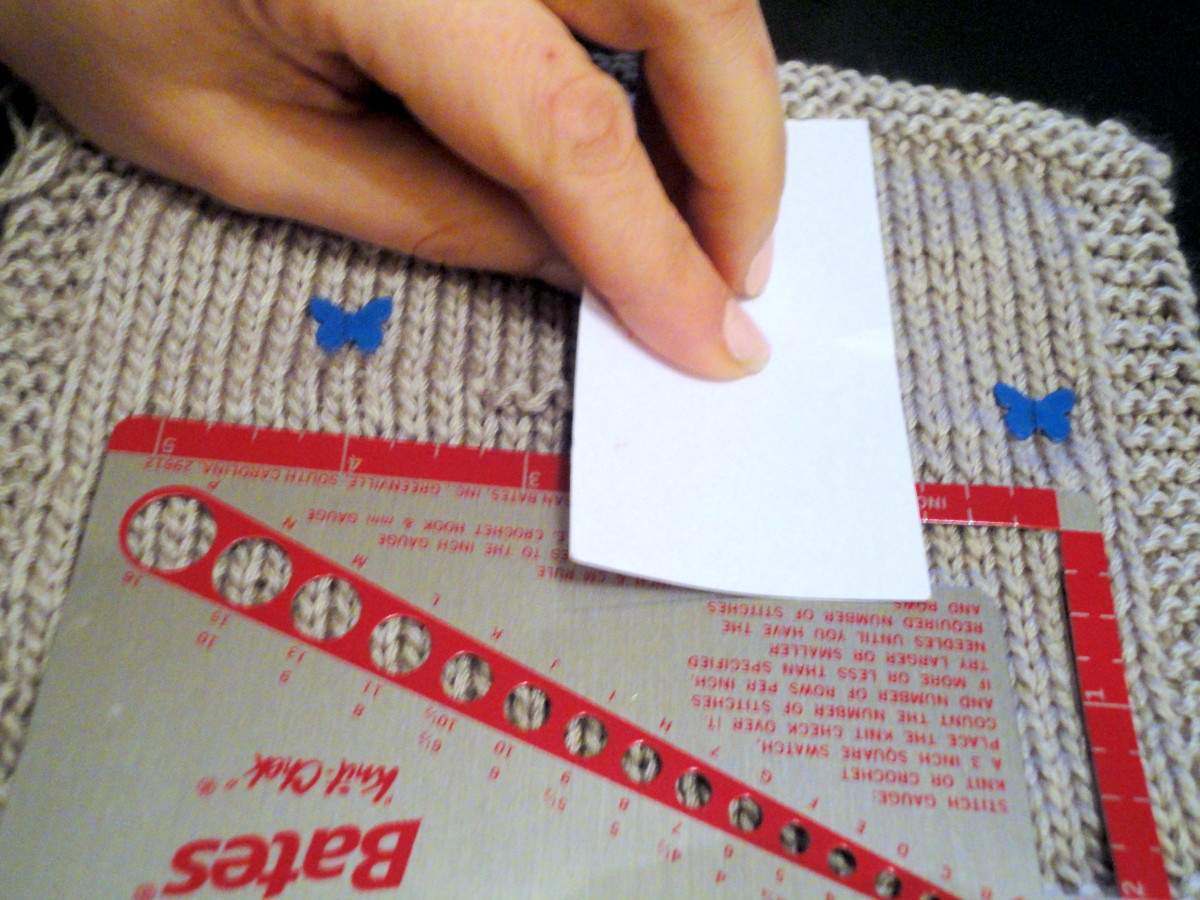 Using a knit-check ruler by Susan Bates, sewing pins and a business card, carefully count your stitches and rows.