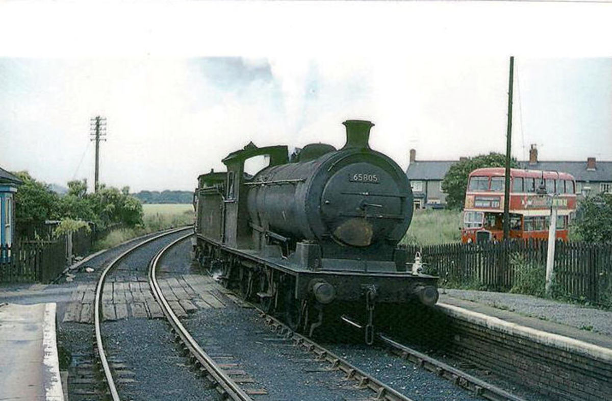Class J27 at Hartley crossing, County Durham with a Class K mixed freight working