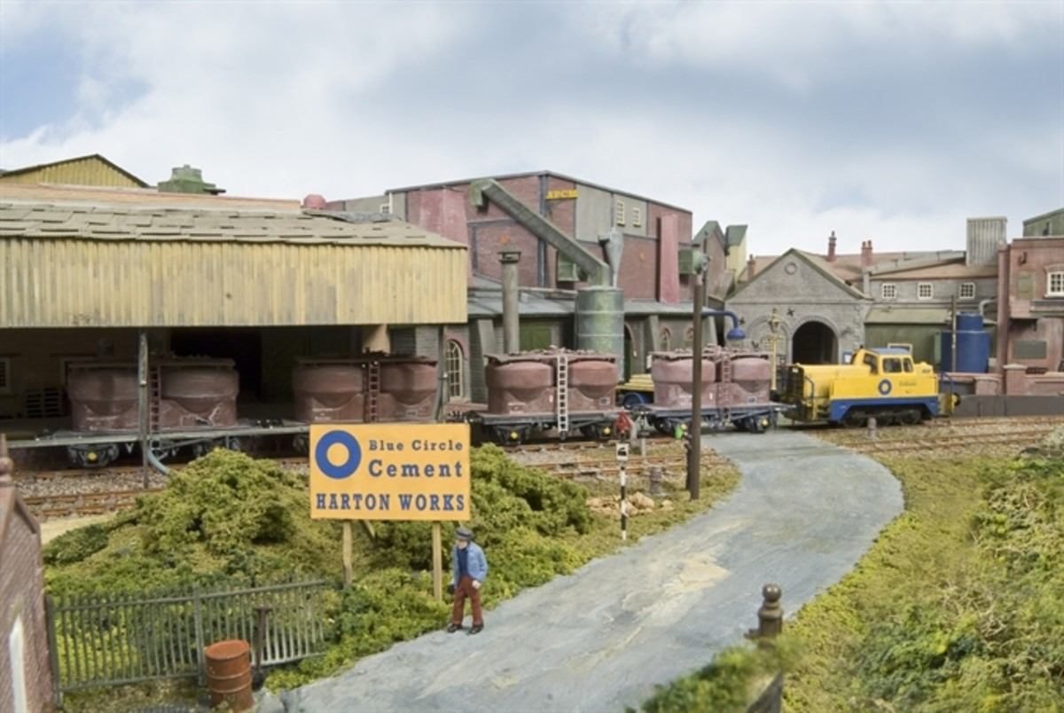 'Ground-level' view of the cement works, detailed industrial site with second generation British Railways cement wagons at rear