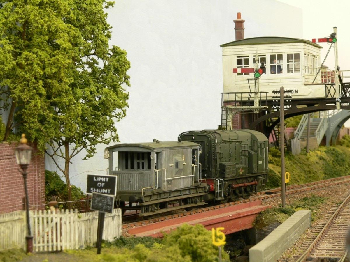 The raised North Eastern Railway signal cabin on the layout with diesel and brakevan