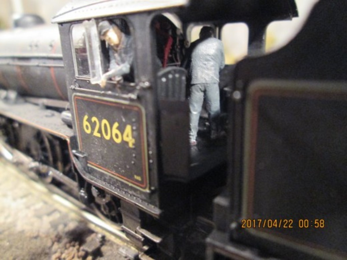 Hornby K1 2-6-0 waits at 'Thoraldby' platform, her driver (LNER engines were left-hand drive for the benefit of Scots' drivers, NER were right-hand drive (no need to leave their region aside from maybe Edinburgh or Doncaster). Fireman busy topping up