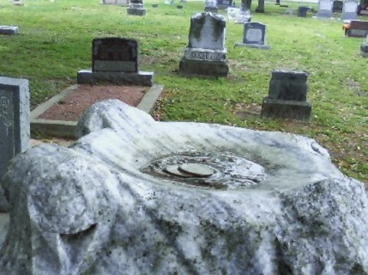 The top of the tomb stone has a curved well that appears as if a ball could have rested here.