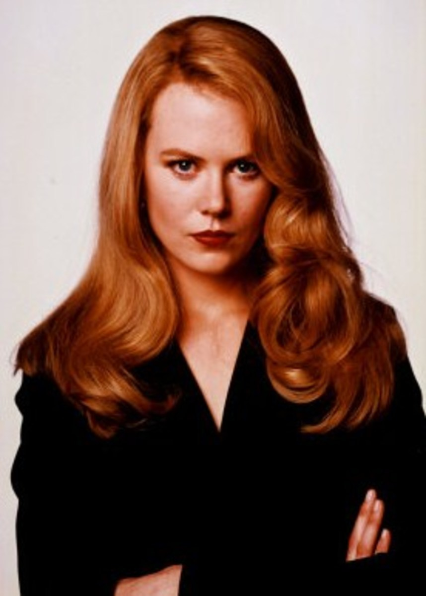 Nicole Kidman. Red hair and blue eyes.