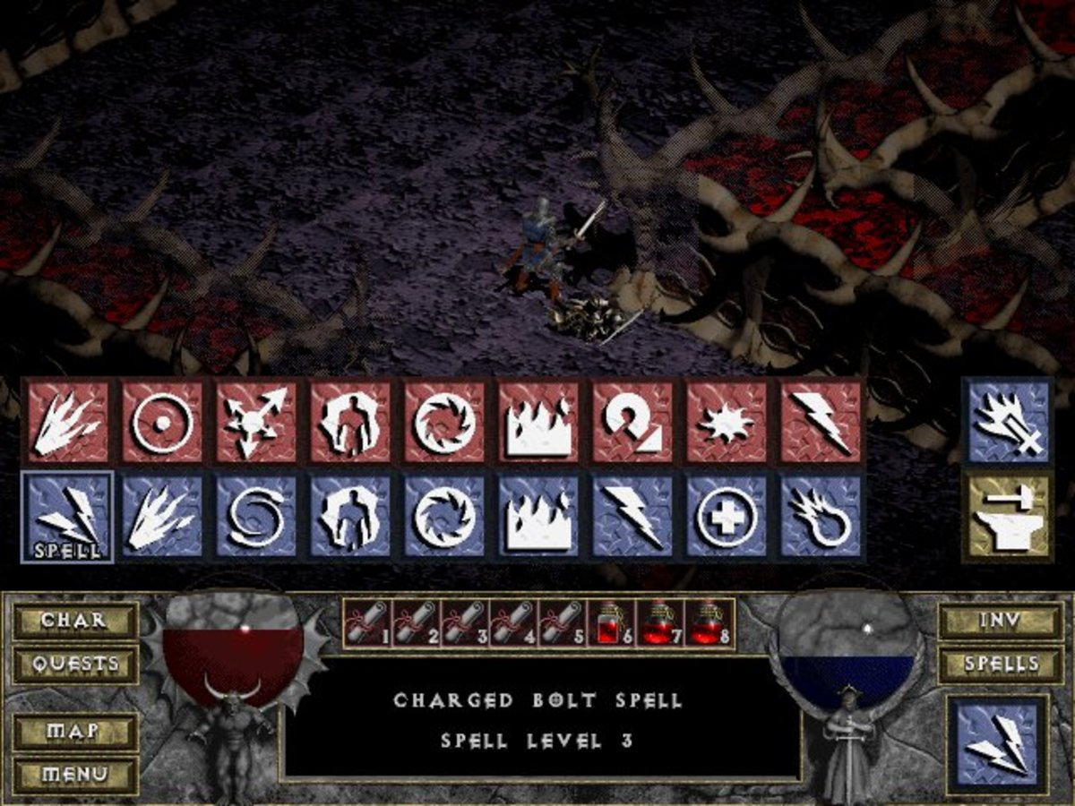 You can access the spell and scroll shortcut menu by clicking on the Spell icon in the lower right corner of the HUD.