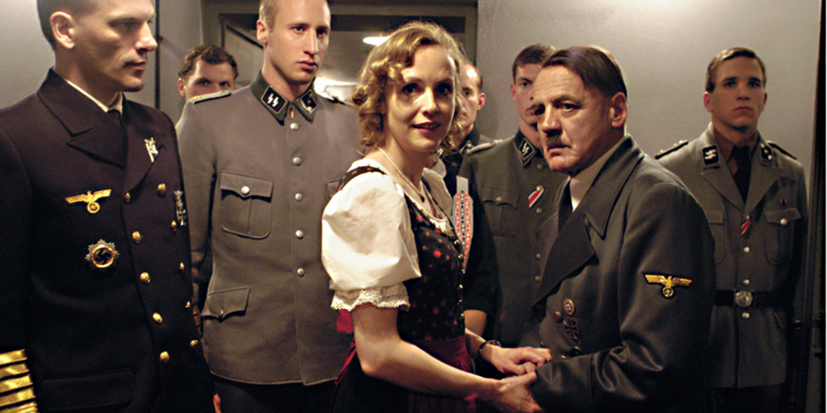 Juliane Kohler gives a truly accomplished performance as Eva Braun, here seen with Hitler and his entourage of generals and advisors