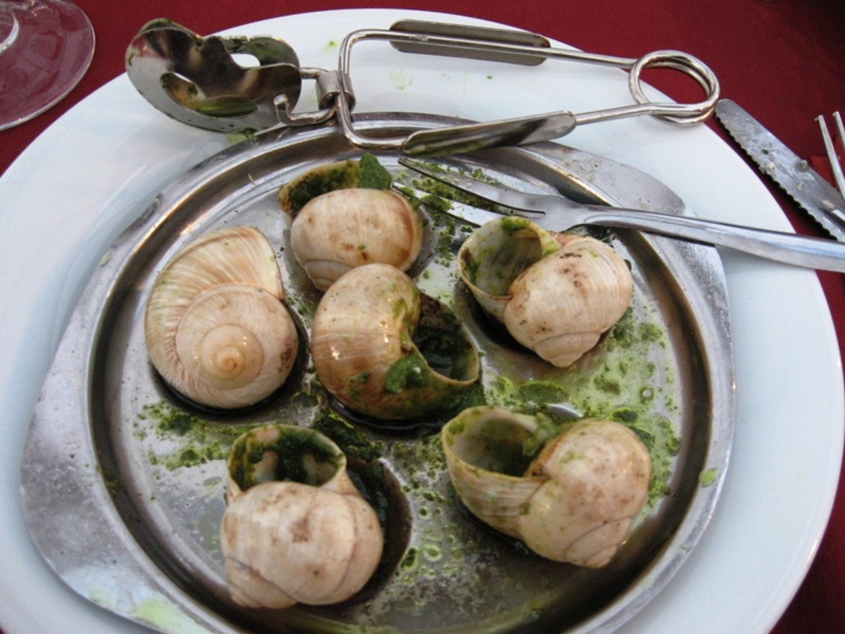 Cooked Snails with Special Utensils.