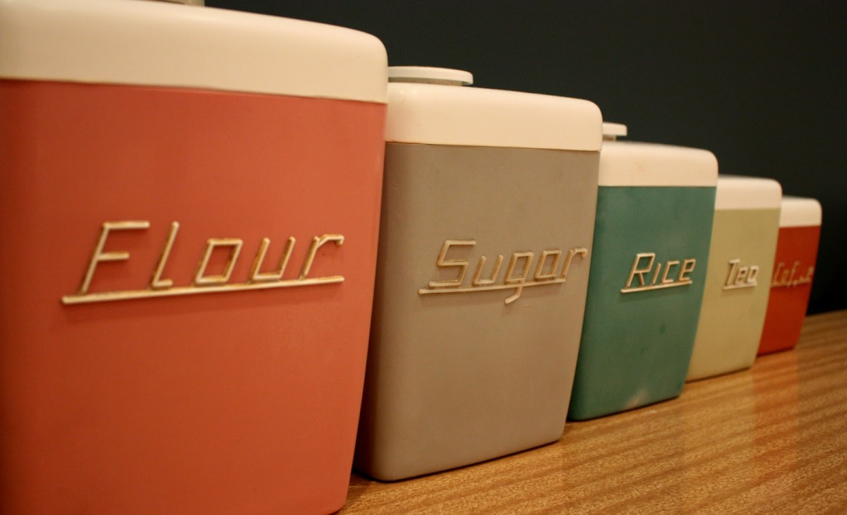 Colourful vintage kitchen canisters.