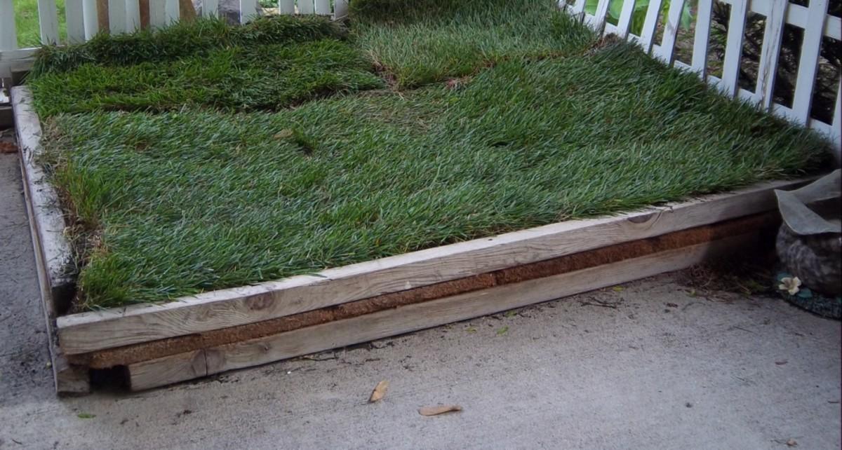 Plywood between 4 foot 2x2 pieces of lumber