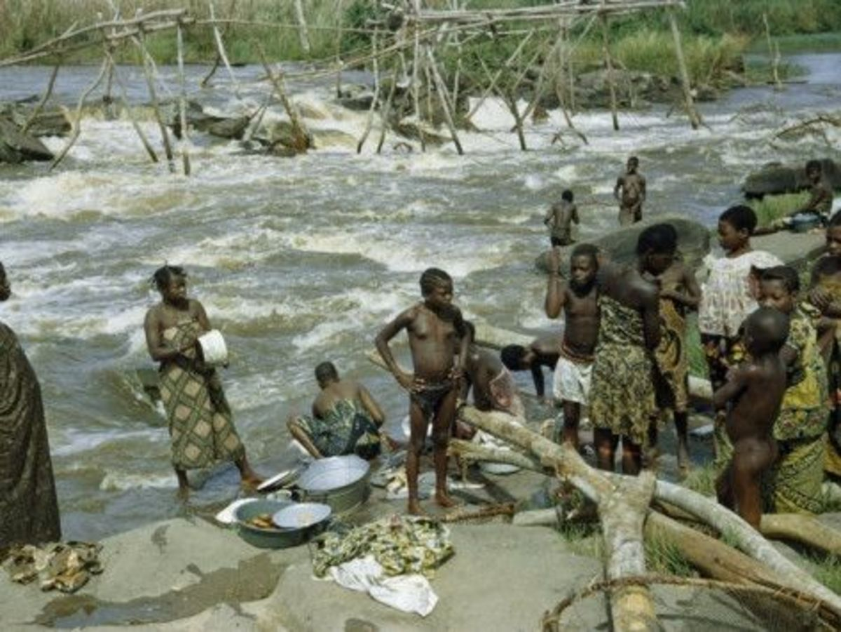 Women and Children Wash Clothes and Dishes in Rapids of Congo River