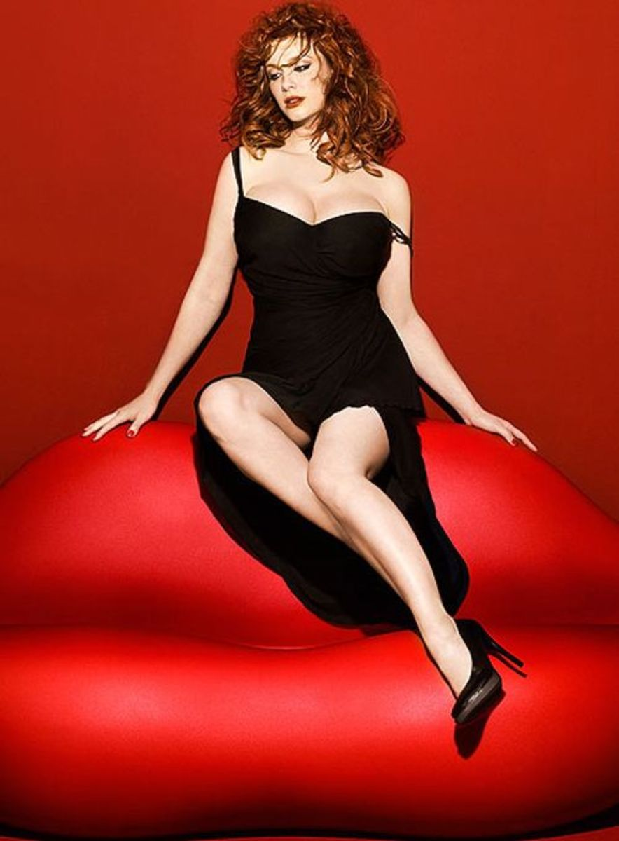 Christina Hendricks in a high slit full length gown and black pumps