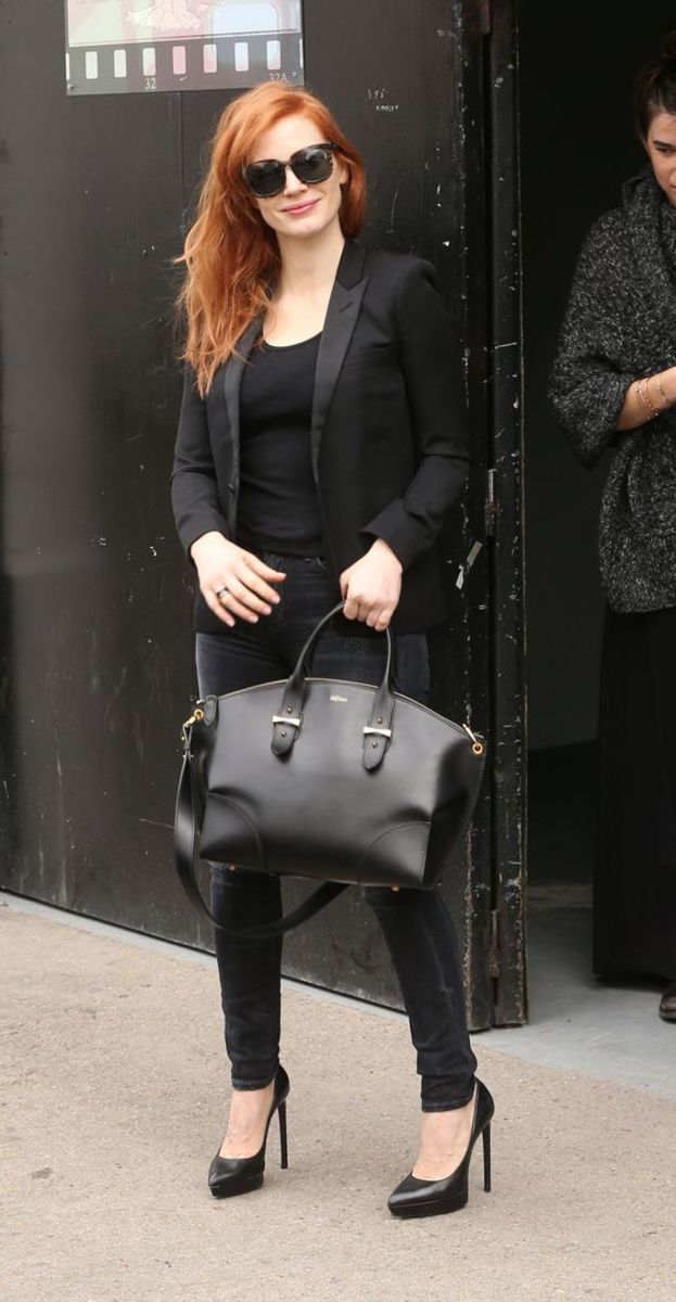 Jessica Chastain street style in black trousers with black stilettos