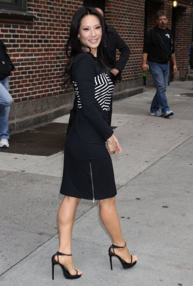 Lucy Liu in a Little black dress and ankle strap high heel sandals