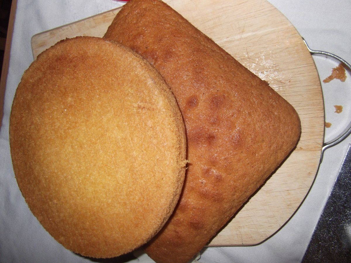 Put the square cake on an angle and place the round cake on top just under halfway on the square cake. Cut round the round cake.