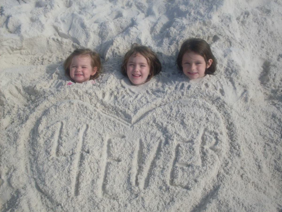 "Chloe, Audrie, and Isabell say, ""We don' need no stinkin' beach chairs!"""