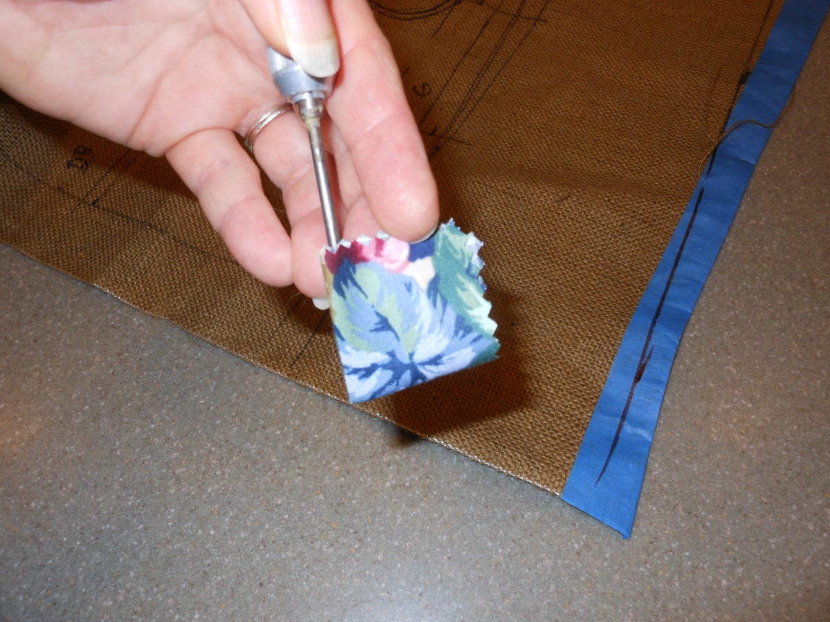 this is the fabric folded into a square with the prodder inserted.