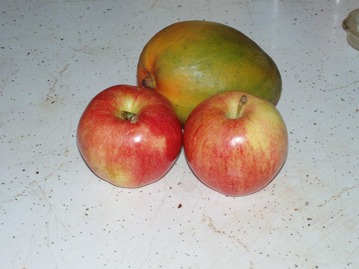 Mangos and apples contain vitamin C.